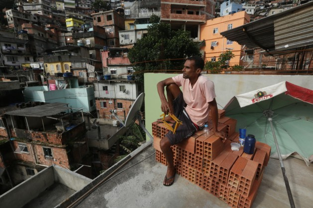 Wide_of_Ricardo_on_rooftop_in_Rocinha_favela (1).jpg